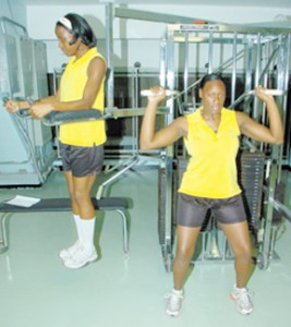 Senior netball players Tracey Robinson (left) and Nardia Hanson go through their routine during a training session at the gym inside the National Stadium complex last Wednesday. (Photo: Joseph Wellington)