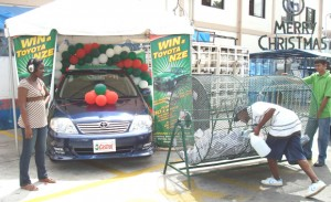 A Guyoil customer drawing the name for the winner of the car in the Castrol GTX promotion.