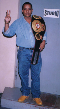 Ramnarayan poses with Andrew Lewis' championship belt shortly after the former world champion returned home after knocking out James Page .