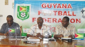 Administrator of the Super League, Kirk Douglas (centre) briefs the media of matters pertaining to the League and the Women's world cup qualifiers. Lawrence Griffith is left, while GFF Vice President Franklin Wilson is at right.
